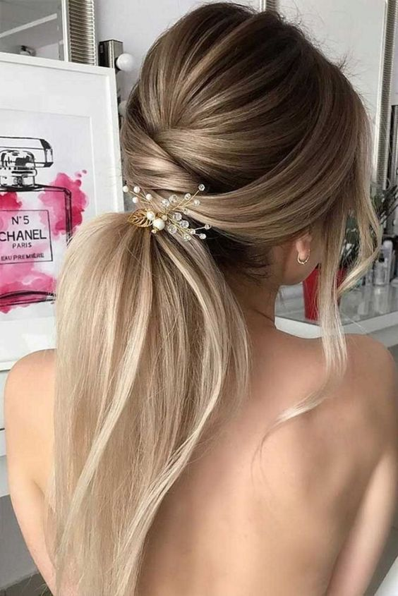 Beautiful bridal hairstyle, as well as the makeup of the bride is the final accent of the wedding image, which you can amaze and enchant, thereby once again fall in love with the groom.