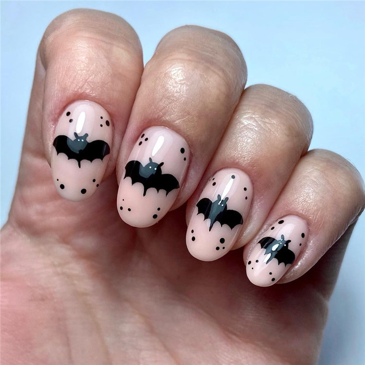 Next, we have 10 bats nails deisgn for Halloween. Some bat nails looks cute while some looks spooky. Take a look and get nails design inspiration. #HalloweenNails #BatNails