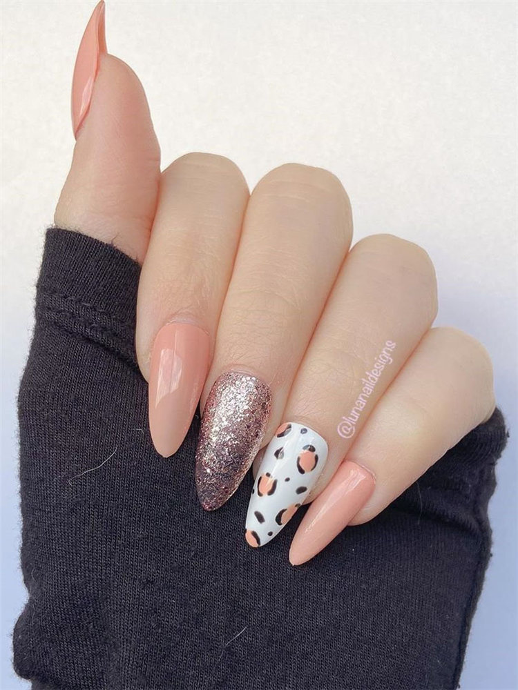 Here we have leopard nails designs. All of the nails have a different design including white coffin shaped, almond shaped; matte, glitter and even clear nails. #NailArt #LeopardNails